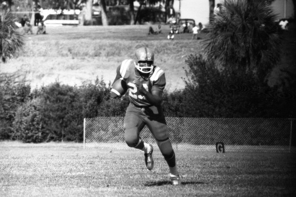 Paremore running the ball during FAMU football game at Bragg Memorial Stadium in Tallahassee, Oct. 27, 1962. Florida Memory.